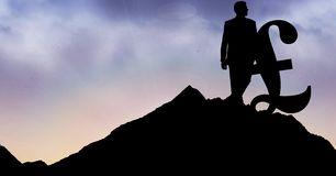 Silhouette businessman with pound sign on mountain against sky. Digital composite of Silhouette businessman with pound sign on mountain against sky royalty free stock image