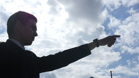 Silhouette of Businessman Showing Direction, Leader Pointing with Finger, stock video footage