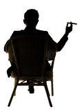 Silhouette of businessman sit Royalty Free Stock Image
