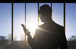 Silhouette of businessman with smartphone Royalty Free Stock Images