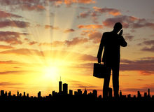 Silhouette of  businessman talking on the phone Royalty Free Stock Photos