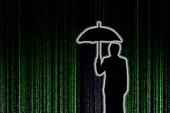 Silhouette of businessman with umbralla through the green matrix Royalty Free Stock Images