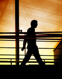 Silhouette of a businessman walking Royalty Free Stock Photo