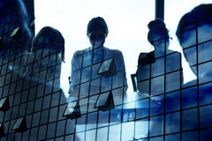 Silhouette of businessperson in office with skyscraper effect. concept of partnership and teamwork. Silhouette of businessperson in a modern office with Stock Image