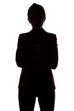 Silhouette of businesswoman with arms crossed Royalty Free Stock Photo