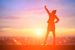 Silhouette of businesswoman. Silhouette of business woman feel excited with sunset Stock Images
