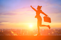 Silhouette of businesswoman. Silhouette of business woman feel excited with sunset Royalty Free Stock Image