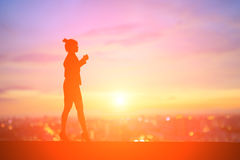 Silhouette of businesswoman. Silhouette of business woman feel excited with sunset Royalty Free Stock Photography
