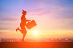 Silhouette of businesswoman. Silhouette of business woman running with sunset Royalty Free Stock Images