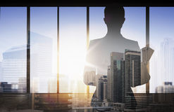 Silhouette of businesswoman with folder over city Stock Images