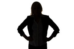 Silhouette of businesswoman with hands on hips Royalty Free Stock Image
