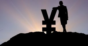 Silhouette businesswoman leaning on yen sign against sky. Digital composite of Silhouette businesswoman leaning on yen sign against sky Royalty Free Stock Image