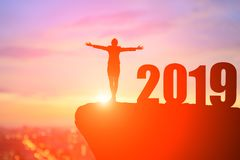 Businesswoman stand on the moutain with 2019 year stock photography