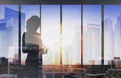 Silhouette of businesswoman with tablet pc Stock Photos