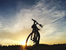 Silhouette of bycicle. Silhouette of a bycicle in front of sunset Stock Photos