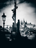 Silhouette of the Calvary Cross. With Prague Castle in distance. Czech Republic Royalty Free Stock Photos