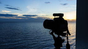 Silhouette of camera at dusk Royalty Free Stock Images