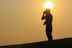 Silhouette camera man. With the sun over his head Stock Photos