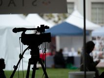 Silhouette of camera set up at an outdoor festival stock photos