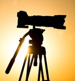 Silhouette of a camera on a tripod at sunset.  Royalty Free Stock Images