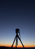 Silhouette of camera on tripod Stock Images