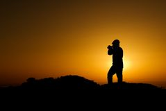 A silhouette of cameraman with golden light stock photography