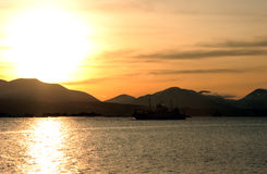 Silhouette of Car Ferry at Sunset. Silhouette of a car ferry crossing the Molde Fjord in Norway at sunset stock photo