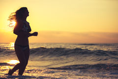 Silhouette of carefree woman on the beach Stock Photography
