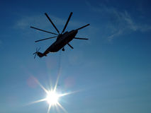 Silhouette cargo helicopter Royalty Free Stock Photos