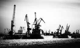Silhouette of cargo port skyline with cranes Stock Image