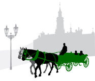 Silhouette of a carriage. With tourists in Prague against Loretta Stock Photography