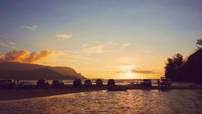Silhouette of Cars in Between Body of Water during Sunset Royalty Free Stock Image