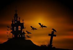 Silhouette of a castle and flying bats over the cemetery Royalty Free Stock Images