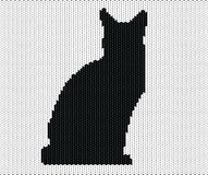Silhouette of cat from knitted texture Royalty Free Stock Photos