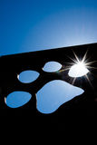 Silhouette of a cat paw with bright sunlight Stock Images