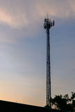 Silhouette cell phone towers with twilight sky. Royalty Free Stock Photography