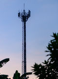 Silhouette cell phone towers with twilight sky. Royalty Free Stock Images