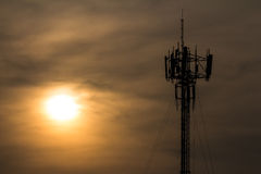 Silhouette of cellphone mast Stock Photography