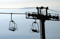 Silhouette of chairlifts in Semnoz, France Stock Photo