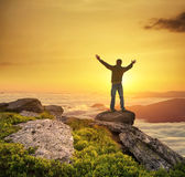 Silhouette of a champion. On mountain peak. Active life concept royalty free stock image