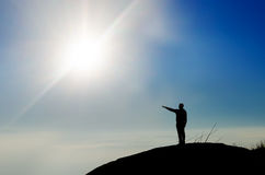 Silhouette of a champion on mountain top Royalty Free Stock Photography
