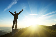 Silhouette of a champion. On mountain top. Sport and active life concept royalty free stock photography