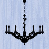 Silhouette of chandelier on blue wallpaper Stock Photos