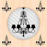 Silhouette of chandelier on peachy wallpaper Royalty Free Stock Images