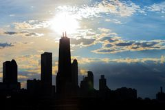 Silhouette of Chicago skyline viewed from the pier with orange a stock photo