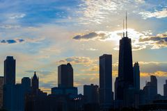 Silhouette of Chicago skyline viewed from the pier with orange a royalty free stock photos