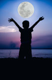 Silhouette of child enjoying the view at riverside. Cool colors Royalty Free Stock Photo