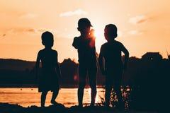 Silhouette child fishing. Silhouette child fishing on lake leisure life people Stock Image