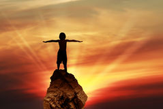 Silhouette of child holding his hands up stock photos