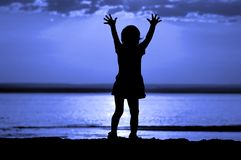 Silhouette child on moon night Stock Photography